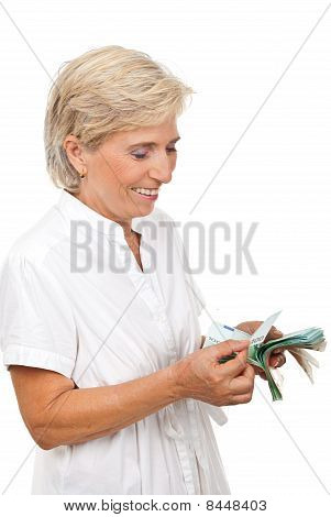 Smiling Senior Woman Counting Money