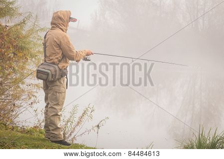 Fisherman on the autumn background
