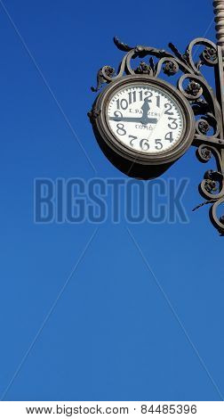 A Clock Outside A Building In Lake Como In Varenna, Italy