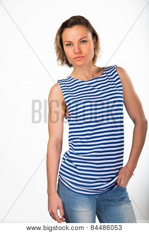 Athletic blonde in a blue striped sweater and jeans,