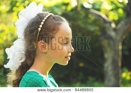 Thinking about - portrait of beautiful pondering little girl - at the summmer sunset