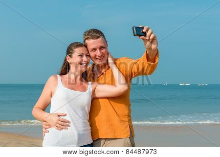 Couple Photographed In Memory On The Background Of The Sea