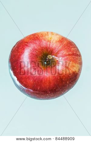Fresh Big Red Apple In Blue Water