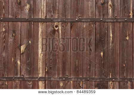 Wooden texture with metal decorations