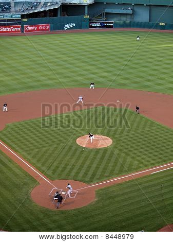Athletics Brett Anderson Throws Pitch As Ball Leaves His Hand With Runner Taking Lead From 2Nd