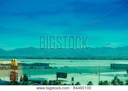 Las Vegas, Nevada, Usa - June 11, 2013: Runway Of Mccarran Airport With Airplane And Helicopter Clim