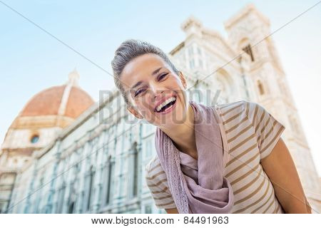 Portrait Of Happy Young Woman In Front Of Cattedrale Di Santa Ma