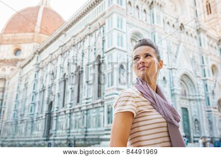 Young Woman In Front Of Cattedrale Di Santa Maria Del Fiore In F