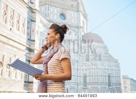 Young Woman With Map And Audio Guide In Front Of Cattedrale Di Santa Maria Del Fiore In Florence, It