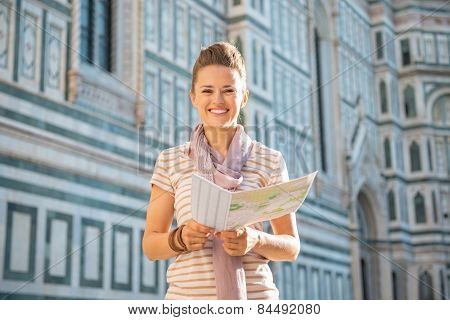 Happy Young Woman With Map In Front Of Cattedrale Di Santa Maria Del Fiore In Florence, Italy