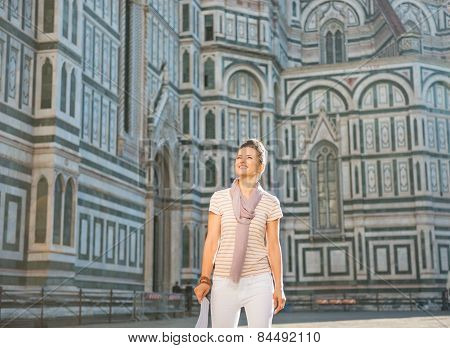 Young Woman Standing With Map In Front Of Cattedrale Di Santa Ma