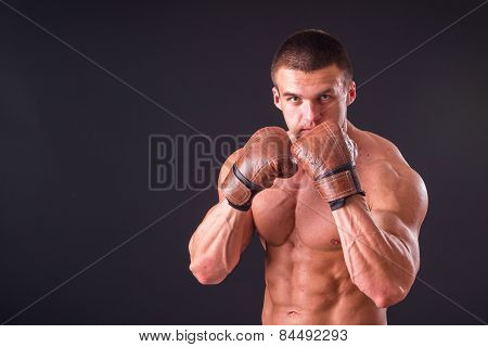 The man in boxing gloves.