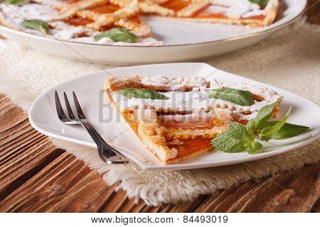 Slice Of Italian Tart With Apricot Close-up. Horizontal