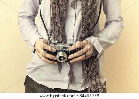 Close Up Of Woman Hand Holding Retro Camera