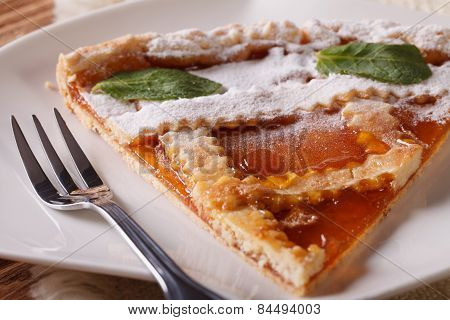 Piece Of Italian Tart With Apricot Jam On The Plate