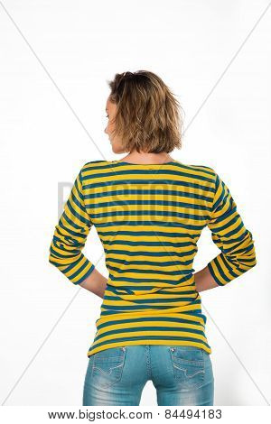 Beautiful young athletic blonde girl posing on a light background in yellow sweater-Chorna.