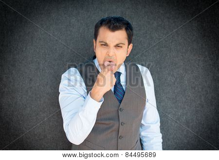 Man Sticking Finger In Mouth