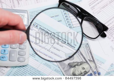Usa 1040 Tax Form 1040 With Magnifying Glass, Glasses, Dollars And Calculator Over It