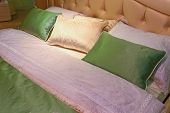 picture of pillowcase  - Luxury hotel room setting with bed and a pillows - JPG