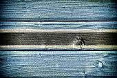 foto of sub-saharan  - flag of Botswana painted on old grungy wooden background - JPG