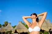 foto of mayan  - Blissful woman at tropical resort caribbean beach enjoying freedom and leisure - JPG