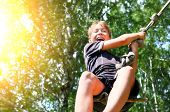 foto of jumping  - Kid Bungee jumping in the Summer Forest - JPG