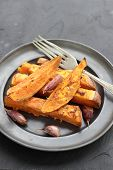 stock photo of potato chips  - Sweet potato roasted chips on a tin plate - JPG