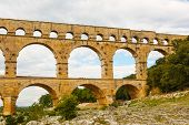 foto of aqueduct  - Pont du Gard is an old Roman aqueduct near Nimes in Southern France - JPG