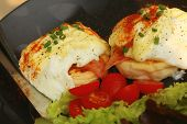 stock photo of benediction  - Eggs Benedict vegetable eggs on a black plate - JPG
