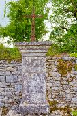 stock photo of crucifix  - Roadside statue with crucifix as seen in many places in France - JPG