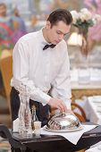 foto of waiter  - Try our tasty specials - JPG
