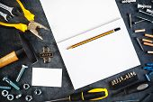 stock photo of tool  - Assorted Do It Yourself DIY Tools and Blank Page Notebook as Copy Space for Home Improvement Project Planning or any Other Workshop Message - JPG