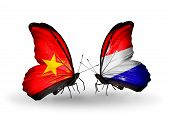 foto of holland flag  - Two butterflies with flags on wings as symbol of relations Vietnam and Holland - JPG