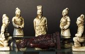 foto of humility  - Dead black king lying in front of white king and his soldiers.