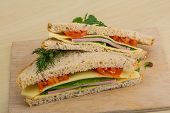 stock photo of tomato sandwich  - Club sandwich with sausages tomato and cheese - JPG