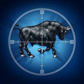 stock photo of crosshair  - Bull market target as crosshairs for rising securities prices as a horned animal in focus representing a bullish financial and economic upward trend - JPG