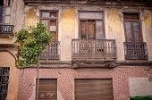 image of valencia-orange  - Old houses and ornamental orange trees in Valencia Cabanyal district - JPG