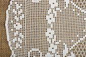 foto of doilies  - handmade doily on burlap for background use - JPG