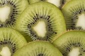 stock photo of villi  - Sliced ripe and juicy KIWI green color - JPG