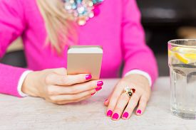 image of cafe  - Woman using new generation mobile phone in cafe - JPG
