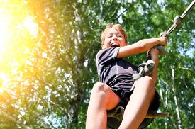 picture of jumping  - Kid Bungee jumping in the Summer Forest - JPG