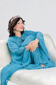 picture of yashmak  - Beautiful Adult arabian woman in blue abaya - JPG