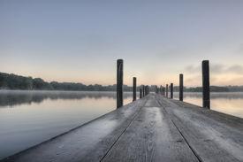 foto of dock a lake  - HDR of Sunrise on Lake Okoboji - JPG