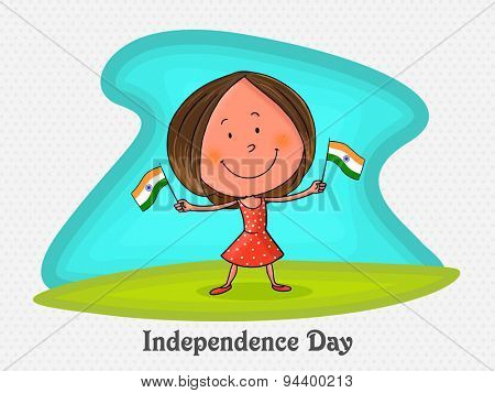 Cute little girl holding national flags in both hands on occasion of Indian Independence Day celebration.