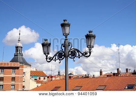 Lantern On A Background Of City Roofs