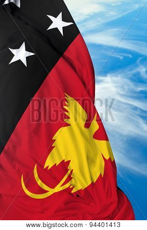 Papua New Guinea waving flag on a beautiful day