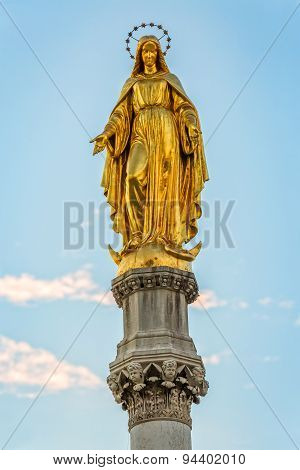 Virgin Mary golden statue