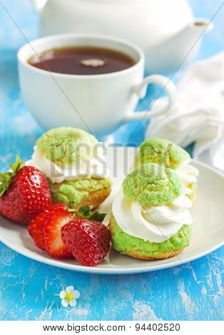 Profiteroles With Strawberry Compote And Whipped Cream.