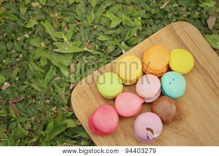 Colorful Of Macaron On The Tray Of Brown Wood.