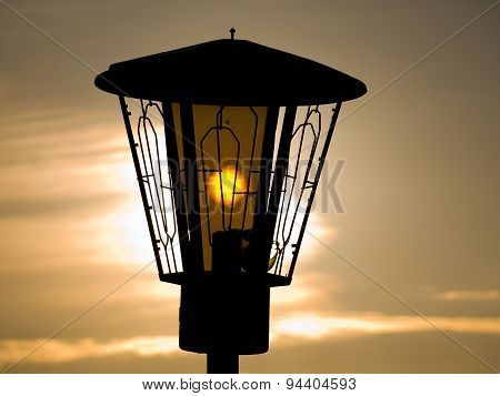 The sun shines through a lantern